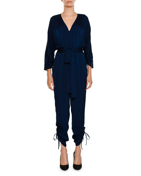Liliana V-Neck Button-Front Tie-Waist Peplum Slim Leg Jumpsuit in Blue