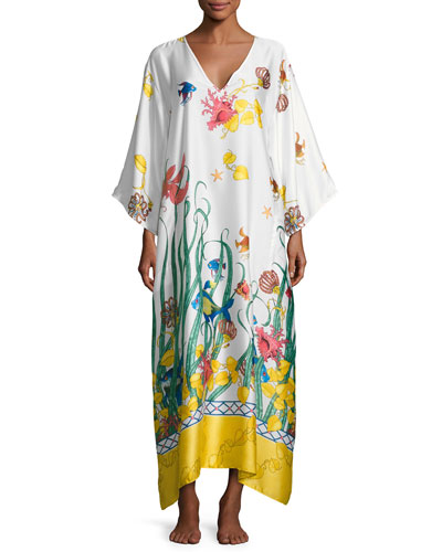 Natori long robe with animal print faux-fur (polyester) trim. Shawl collar; open front. Long sleeves with banded cuffs. Self-tie at natural waist. Patch pockets at hips. Straight skirted bottom. Straight hem. Polyester. Imported.