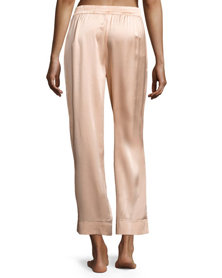 Satin Pajama Pants Back to the stores Address. Opening schedule. Phone. Fax. Cut from glossy satin, these pajama pants are built in a slim silhouette. The cropped length is stylishly complemented by turn-up cuffs and the elasticated waist provides a flattering fit.