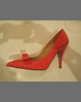 Kate Spade licorice point-toe patent pump, red