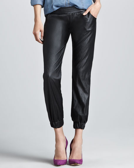 Jan 14, slouchy black leather pants, leather cuffs with feminine details.