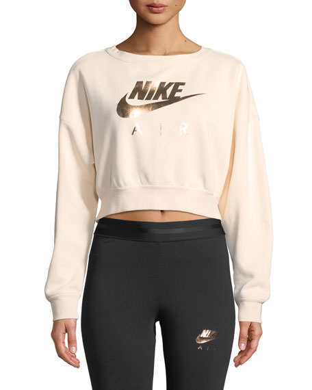 9c1c020d4499 Metallic rose gold Nike Air logo front and center Unique back-zip detail  for style Fleece fabric Wide neckline allows for nonrestrictive comfort  Ribbed ...