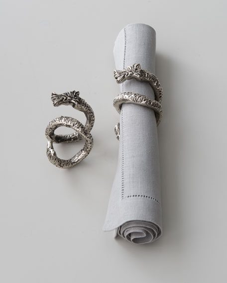 "Four ""Coiled Dragon"" Napkin Rings"