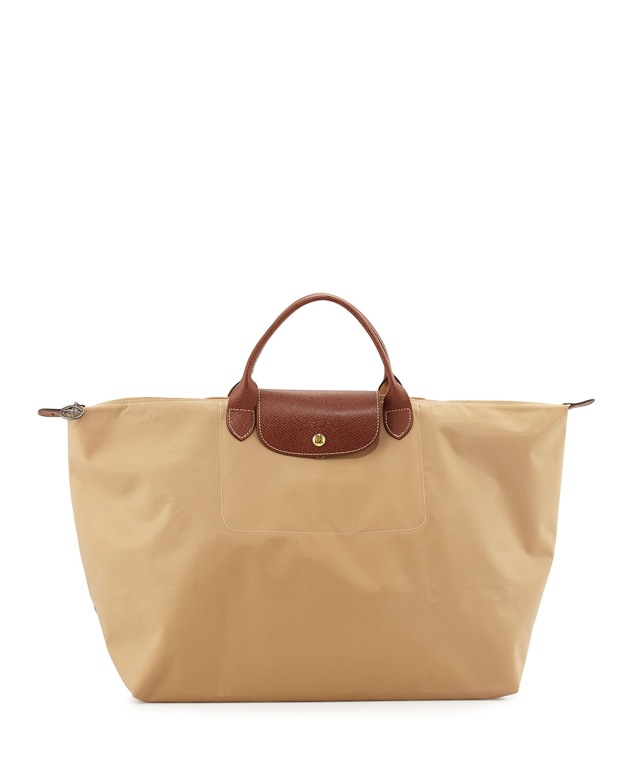 58f1a4e0e44f Quick Look. Longchamp · Le Pliage Large Travel Bag ...