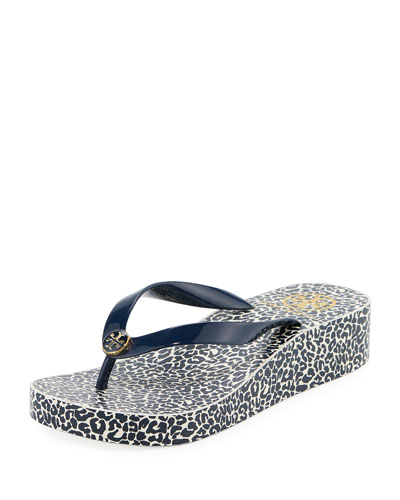 5bbf632a0f207 Tory Burch Printed Wedge Flip Flop from Neiman Marcus - Styhunt