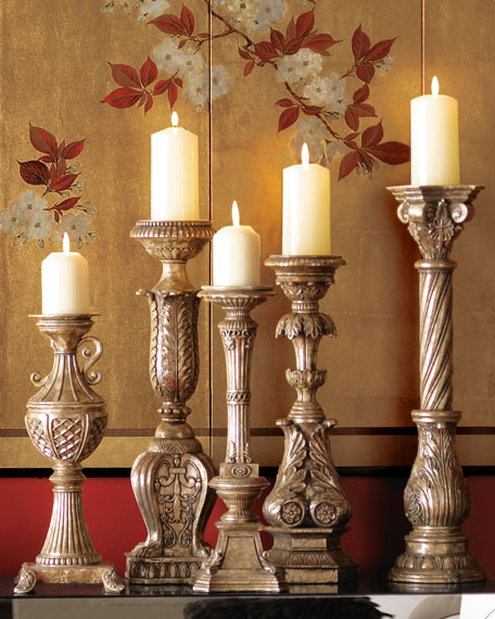 Five Opulent Silver-Washed Candlesticks