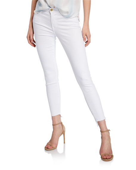 Image 1 of 4: FRAME Le Skinny De Jeanne Mid-Rise Raw Stagger-Hem Jeans