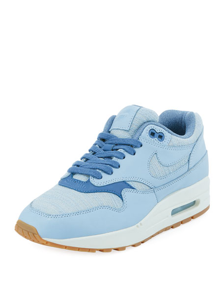 nike light blue womens trainers with striped sole