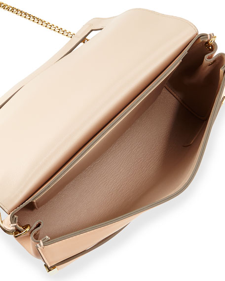Large clutch bag featuring an envelope style funon.ml clutch bagEnvelope style bagButton clasp% other materials35x25cm.