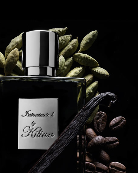 Kilian Intoxicated Travel Spray with its 4 x .25 oz refills