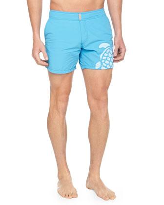 Meperfo Turtle Logo Swim Trunks, Blue